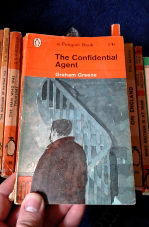 The Confidential Agent by Graham Greene; Penguin Paperback (1895); 1963 edition; cover by Paul Hogarth